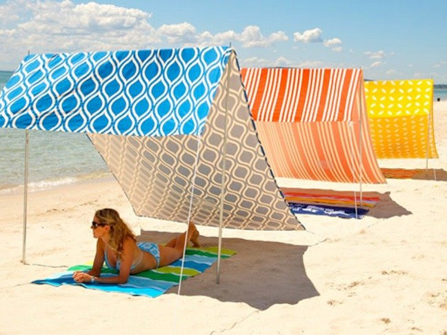 A Simple & Stylish Solution For Staying Cool On The Beach
