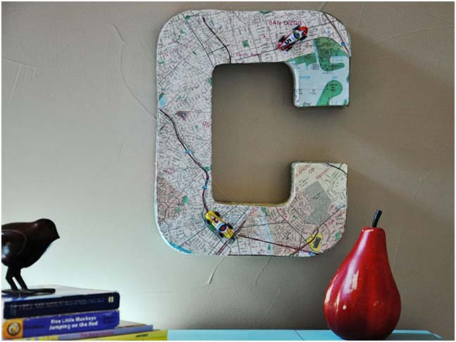 large letter C covered in maps