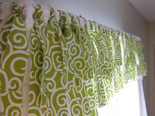 Window valance made with alternating strips of white and green spiral fabric