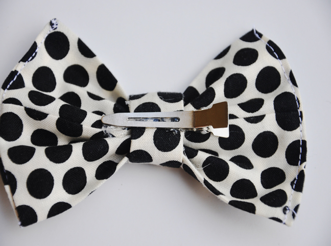 attaching a barrette to the hair bow