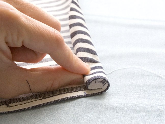 rolling up one side of the fabric