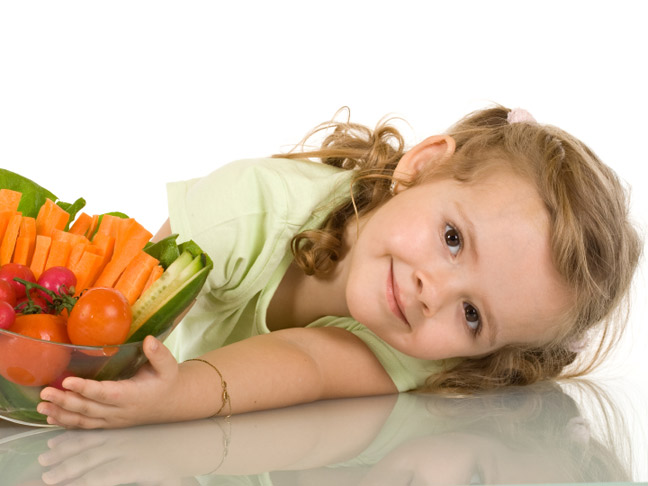 Little girl with vegetables