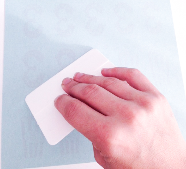 adding adhesive paper to the tattoo paper
