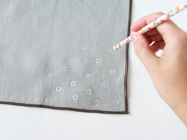 Use a straw to stamp pola dots on napkins