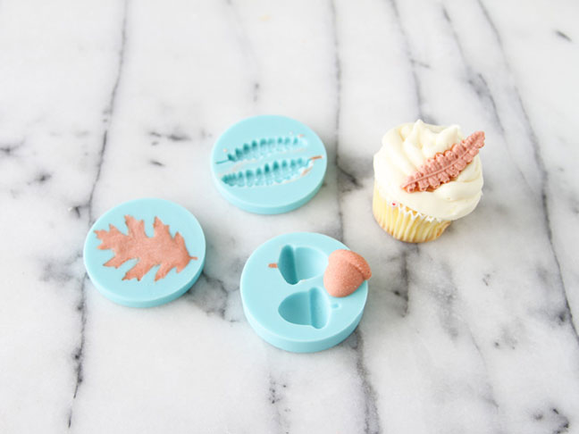 Adding the complete cupcake toppers to cupcakes
