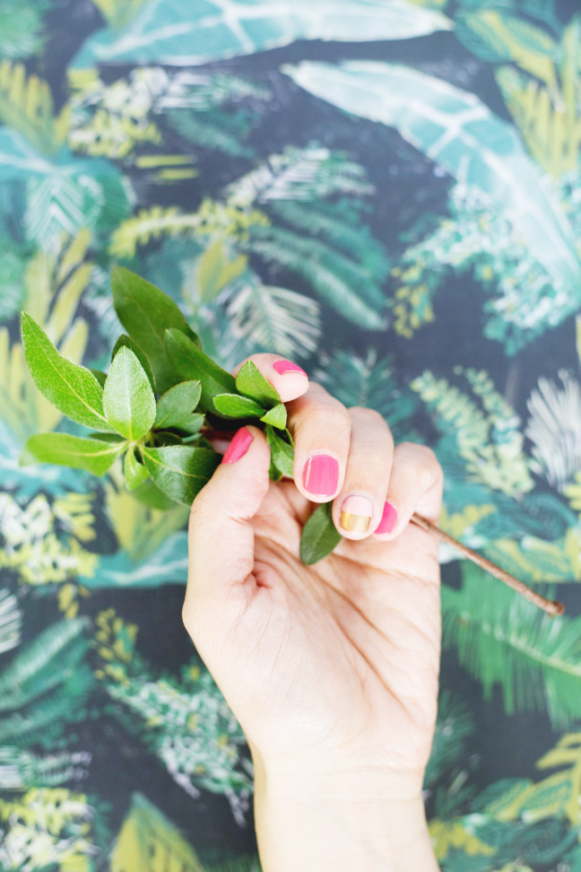two-tone-mani-hand-holding-leaves