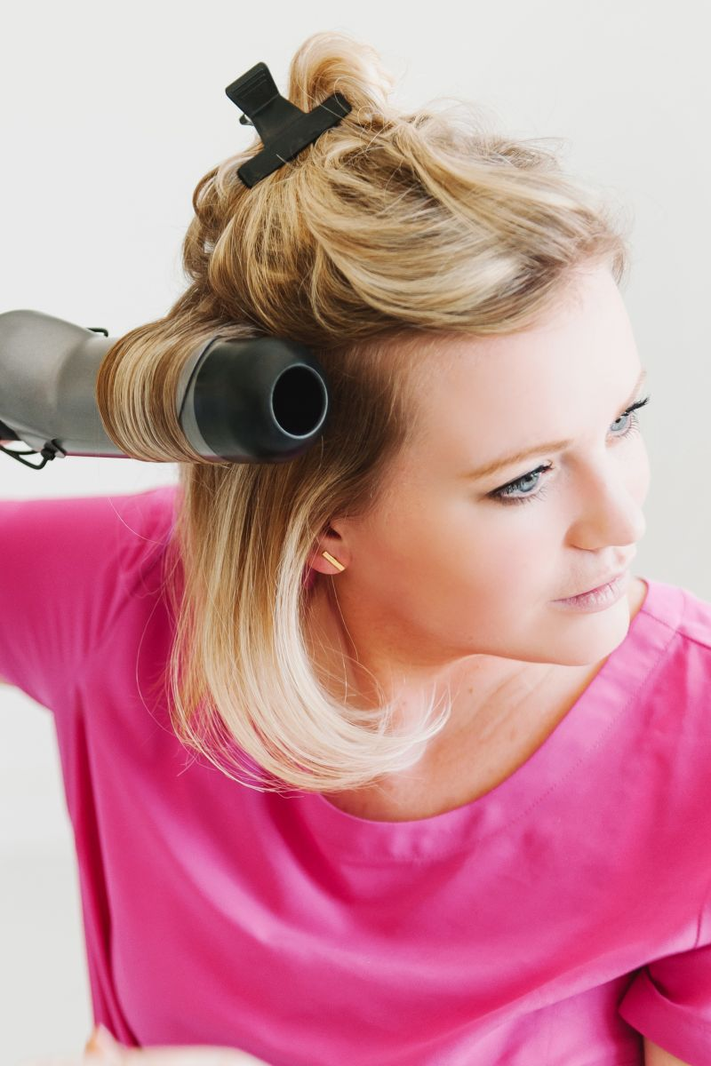 use_a_large_barrel_curling_iron_for_a_faux_blowout_at_home