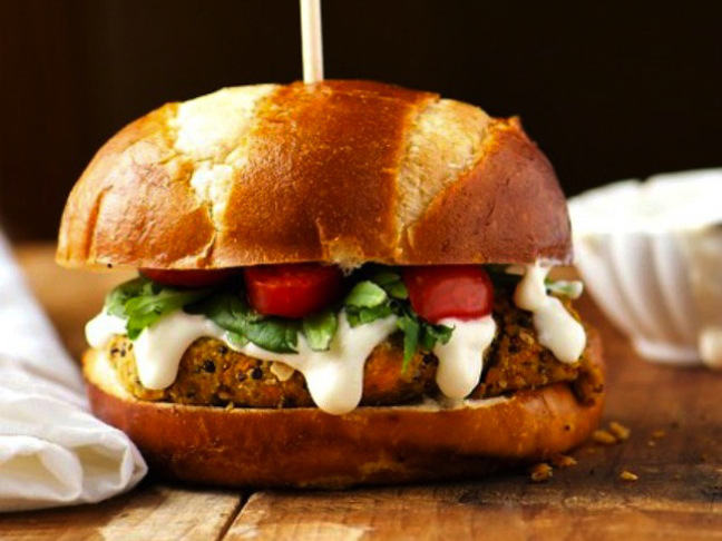 veggie burger with green and white sauce
