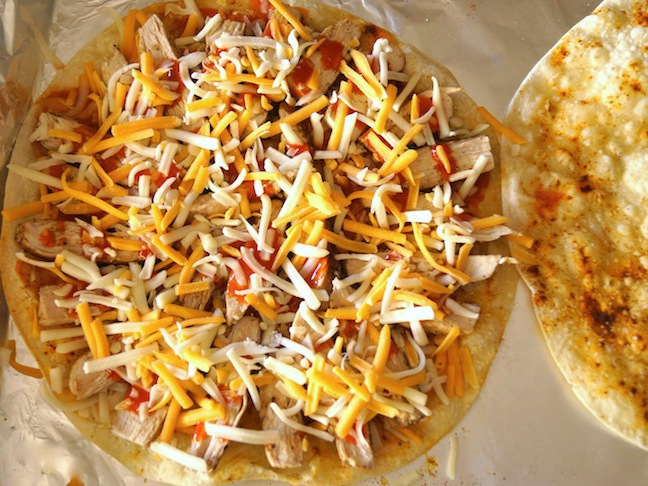 cheese sprinkled on tortilla red sauce