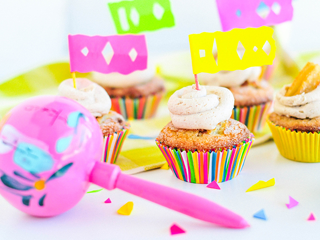 churro cupcakes with papel picado flags