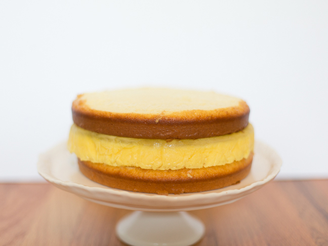 pineapple layer cake on white stand