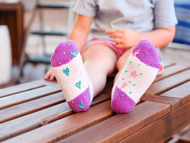Keep your toddler safe from slips and spills by adding puff paint to the bottoms of their socks \\ \\ Toddler Proofing Tricks You've Never Heard of Before