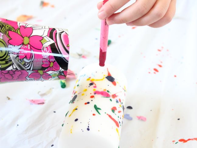 splattering melted crayon onto white candle