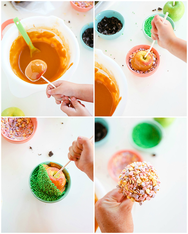toddler dipping caramel apples into candy
