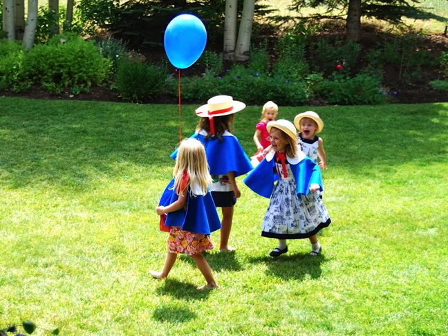 girls-running-blue-cape-balloon-madeline-party
