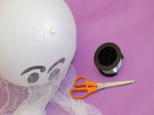tying fishing line to ghost balloon