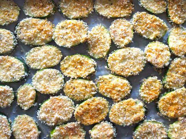 raw coated zucchini slices-parchment paper