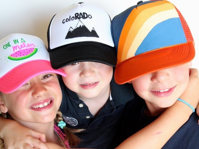 kids-wearing-trucker-hats-with-colorful-diy-art-mountains-watermelon-orange-and-blue-rainbow