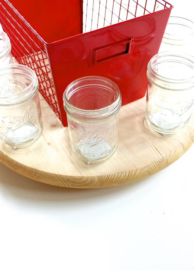 red-basket-with-mason-jars-on-a-round-wood-pine-lazy-susan