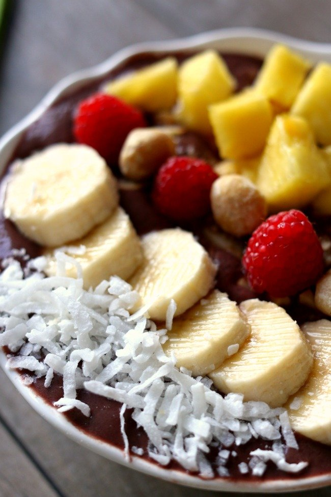 Acai bowls are like a tangy smoothie with toppings in a bowl. Because acai berries are a super food and are full of antioxidants and phytochemicals these smoothie bowls not only taste delicious (like dessert) but they are super nutritious for you too.