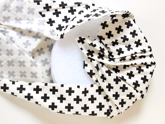 black-and-white-cross-fabric-covering-a-foam-circle