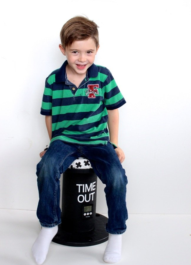 boy-smiling-on-a-time-out-chair
