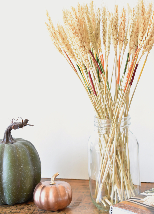 Add A Pop of Color This Fall With Embroidery String On A Dried Wheat Arrangement