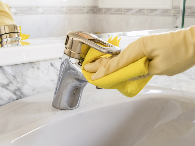 Clean hard water stains with vinegar